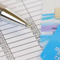 Debit Credit Spreadsheet Within Pen And Credit Cards On A Spreadsheet. Shallow Depth Of Field