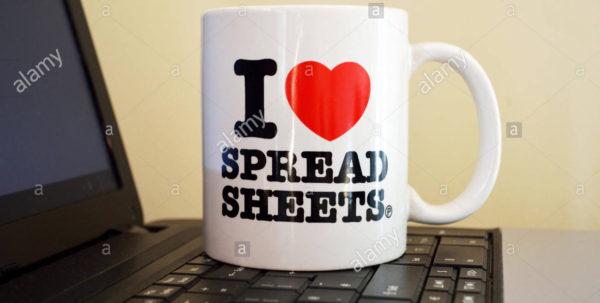 "I Love Spreadsheets Regarding An ""i Love Spreadsheets"" Mug On A Laptop Keyboard Stock Photo"