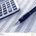Spreadsheet Calculator Intended For Pen And Calculator On Cash Financial Spreadsheet Stock Image  Image